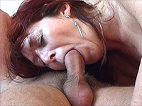 Redhead granny giving hot blowjob.